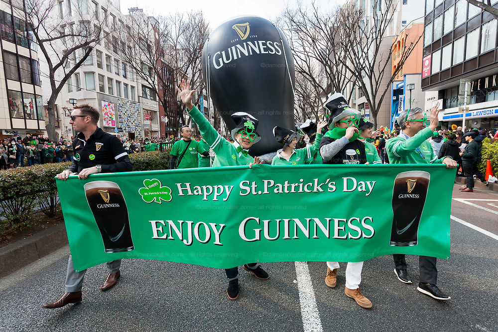 """Guinness at the 27th Saint .Patrick's Day Parade in Omotesando, Tokyo, Japan. Sunday March 17th 2019. Started in 1992 by the Irish Network, Japan, and supported by the Embassy of Ireland,; the parade, along with the """"I Love Ireland Festival"""" held nearby is Asia's  largest Irish event."""
