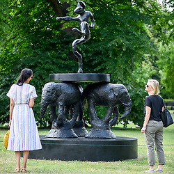 "© Licensed to London News Pictures. 03/07/2019. LONDON, UK. Women view ""Composition"", 2008, by Barry Flanagan. Frieze Sculpture opens in Regent's Park, London's largest free display of outdoor art.  Works from 23 international artists are on display 3 July to 6 October 2019.  Photo credit: Stephen Chung/LNP"