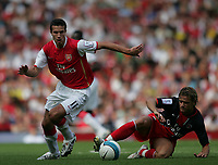 Photo: Lee Earle.<br /> Arsenal v Paris Saint-Germain. The Emirates Cup. 28/07/2007.Arsenal's Robin van Persie (L) and Jerome Rothen.
