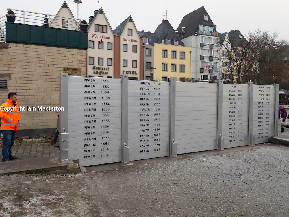 Installing flood defence barriers beside River Rhine in central Cologne during flooding conditions Germany