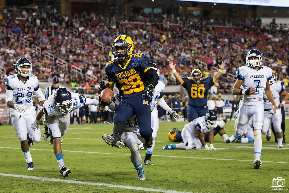 Milpitas running back Cros Chavez, 28, leaps into the end zone for a touchdown against Valley Christian High School during Friday Night Lights at Levi's Stadium in Santa Clara, California, on September 18, 2015.  Milpitas went on to lose 22-21 against Valley Christian.  (Stan Olszewski/SOSKIphoto)