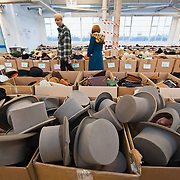LONDON, ENGLAND - FEBRUARY 06: Gentlemen top hats on display at Angels Retro Sale on February 6, 2010 in London, England. Angels Costumiers are selling over 25,000 items of clothing and accessories from their warehouse in Wembley on February 6, 2010. The Retro Sale features fashion items from the 1950s to the 1990s as well as period military uniforms. Angels is the world's longest-established supplier of costumes to film and theatre, founded in 1840 the company supplies costumes to over 1000 productions per year.  (Photo by Marco Secchi/Getty Images)