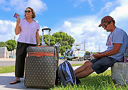 Tourists Erica Bourke of Australia and Jacob Botha of South Africa wait for a Greyhound bus on Wednesday, September 6, 2017 as they evacuate Key Largo in anticipation of the arrival of Hurricane Irma. Photo by Al Diaz/Miami Herald/TNS/ABACAPRESS.COM