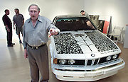 "American pop culture artist Robert Rauschenberg directs the placement of his artwork next to one of his ""Beamer"" collages at an art gallery in Naples, Florida in this January, 2002, file photo. The 82-year-old died Monday, May 12, 2008, of heart failure according to Jennifer Joy, his representative at PaceWildenstein gallery in New York. Rauschenberg's incorporation of everyday items, both common place and the odd in his artwork earned him the reputation as a pioneering pop artist, gaining fame in the 1950's. Photo by Colin Braley."