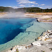 The beautiful Sapphire Pool hot spring in Biscuit Basin, Yellowstone National Park, Wyoming.