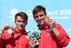 England's Daniel Goodfellow (left) and Tom Daley (right) with their gold medals in the Men's Synchronised 10m Platform Final at the Optus Aquatic Centre during day nine of the 2018 Commonwealth Games in the Gold Coast, Australia. PRESS ASSOCIATION Photo. Picture date: Friday April 13, 2018. See PA story COMMONWEALTH Diving. Photo credit should read: Danny Lawson/PA Wire. RESTRICTIONS: Editorial use only. No commercial use. No video emulation.