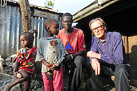 BILL WITH KENNEDY AND HIS CHILDREN,(HIV-EXTREAM POVERTY) IN SHAURIYAKO SLUM.