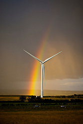 A rainbow is visible behind a wind turbine after a rain shower near Blackwood, South Lanarkshire in Scotland. The three large wind turbines went operational along the B7078 in 2009, providing power for around 3,000 homes and part of Scotland's growing commitment to renewable energy production.