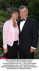TONY & DEBBIE BLACKBURN at a dinner in London on 17th June 2004.  PWI 65