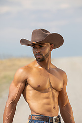 cowboy without a shirt outdoors