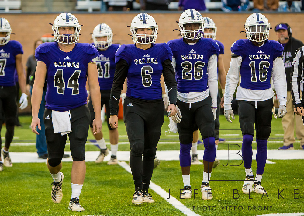 Saluda Tigers captains come out to midfield for the coin flip before the game against the Barnwell Warhorses in the Class AA State Championship game. 2019 Saluda State Championship Football Photos