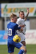 Cove Rangers' Connor Scully (4) and Peterhead's Lyle Cameron (10) battles for possession, tussles, tackles, challenges, during the Premier Sports Scottish League Cup match between Peterhead and Cove Rangers at Balmoor, Peterhead, Scotland on 17 July 2021.