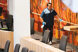 14.03.2020, Hofburg, Wien, AUT, Parlament, Sondersitzung des Nationalrates um das Gesetzespaket, das unter anderem Regelungen im Zusammenhang mit der Bekaempfung der Corona-Pandemie in Bezug auf Betriebsschließungen sowie im Zusammenhang mit Dienstfreistellungen und Kurzarbeit plenumsreif zu machen, im Bild Reinigungskraefte desinfizieren den Plenarsaal // during special session of the National Council to make the legislative package, which among other things, regulations in connection with the fight against the corona pandemic in relation to company closings as well as in connection with leave of absence and short-time work ready for plenum at Hofburg palace in Vienna, Austria on 2020/02/27, EXPA Pictures © 2020, PhotoCredit: EXPA/ Florian Schroetter
