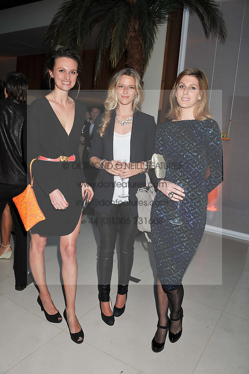Left to right, BRYONY DANIELS, OLIVIA HUNT and SUSANNA WARREN at the Veuve Clicquot Experience at The Hurlingham Party following the Polo in The Park held at the Hurlingham Club, London SW6 on 8th June 2012.