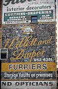 SHOT 7/7/14 10:18:30 AM - An antique hand painted billboard for a furrier on the side of a building in downtown Buffalo, N.Y. Buffalo, N.Y. is the second most populous city in the state of New York. Located in Western New York on the eastern shores of Lake Erie and at the head of the Niagara River across from Fort Erie, Ontario, Canada, Buffalo is the seat of Erie County and the principal city of the Buffalo-Niagara Falls metropolitan area, the largest in Upstate New York. By 1900, Buffalo was the 8th largest city in the country, and went on to become a major railroad hub, the largest grain-milling center in the country and the home of the largest steel-making operation in the world. The latter part of the 20th Century saw a reversal of fortunes: by the year 1990 the city had fallen back below its 1900 population levels. (Photo by Marc Piscotty / © 2014)
