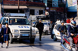 10 February 2005. A UN officer driving in the busy street of Kathmandu