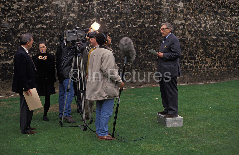 The BBCs veteran political broadcaster, Sir Robin Day stands on an equipment box to make a report to camera on College Green in Westminster, on 17th March 1992, in London, England. Sir Robin Day 1923 – 2000 was an English political journalist and television and radio broadcaster and called the most outstanding television journalist of his generation. He helped transform the television interview, changed the relationship between politicians and television, and strove to assert balance and rationality into the mediums treatment of current affairs.