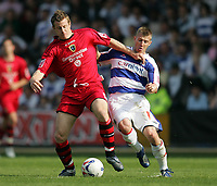 Photo: Lee Earle.<br /> Queens Park Rangers v Cardiff City. Coca Cola Championship. 21/04/2007.QPR's Martin Rowlands (R) battles with Paul Parry.