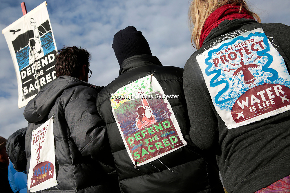 Opponents of the Dakota Access oil pipeline lock arms during a demonstration on the North Dakota capitol grounds on November 14, 2016. Bismarck, North Dakota, United States.