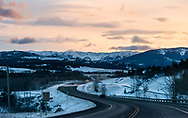 Sunrise over the Crowsnest HIghway, with colourful skies over the cold, snowy landscape of Southern Alberta, Canada