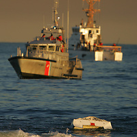 (PMONMOUTH) Bradley Beach 2/1/2005  US Coast Guard boats patrol the scene of an overturned boat found floating in the Bradley Beach Surf.  Michael J. Treola Staff Photographer.....MJT
