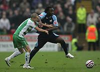 Photo: Lee Earle.<br />Yeovil Town v Swansea City. Coca Cola League 1. 27/10/2007. Swansea's Jason Scotland (R) battles with Nathan Jones