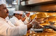 COSTA CROCIERE: cominciano ad uscire i piatti caldi per la cena. getting ready for dinner at the a la carte restaurant. 200 chefs and 300 waiters have to be ready to serce 4146 meals par day