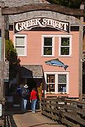 Alaska Ketchikan Two visitors exploring historic Creek Street