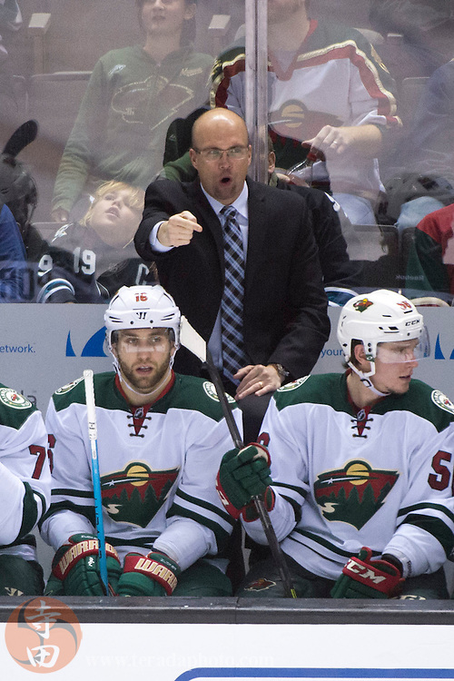 December 12, 2015; San Jose, CA, USA; Minnesota Wild head coach Mike Yeo instructs during the third period against the San Jose Sharks at SAP Center at San Jose. The Wild defeated the Sharks 2-0.