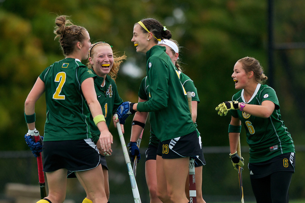 Catamounts midfielder Whitlee Burghardt (2), Catamounts forward Ashley McDonald (1), Catamounts midfielder Alana Izzo (13) and Catamounts forward Taylor Silvestro (6) celebrate a goal during the women's field hockey game between the Maine Black Bears and the Vermont Catamounts at Moulton/Winder Field on Saturday afternoon September 29, 2012 in Burlington, Vermont.