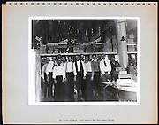 page from a photo album with office workers USA 1945