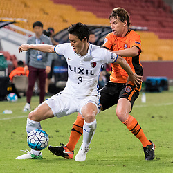 BRISBANE, AUSTRALIA - APRIL 12: Shoji Gen of Kashima and Brett Holman of the Roar compete for the ball during the Asian Champions League Group Stage match between the Brisbane Roar and Kashima Antlers at Suncorp Stadium on April 12, 2017 in Brisbane, Australia. (Photo by Patrick Kearney/Brisbane Roar)