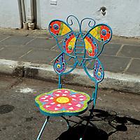 USA, Puerto Rico, San Juan. Artistic mosaic patio chair.