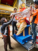 "05 SEPTEMBER 2016 - BANGKOK, THAILAND:   Men unload a statue of Ganesha on the first day of Ganesha Chaturthi celebrations at Shiva Temple in Bangkok. Ganesha Chaturthi also known as Vinayaka Chaturthi, is the Hindu festival celebrated on the day of the re-birth of Lord Ganesha, the son of Shiva and Parvati. The festival, also known as Ganeshotsav (""Festival of Ganesha"") is observed in the Hindu calendar month of Bhaadrapada. The date usually falls between 19 August and 20 September. The festival lasts for 10 days, ending on Anant Chaturdashi. Ganesha is a widely worshipped Hindu deity and is revered by many Thai Buddhists. Ganesha is widely revered as the remover of obstacles, the patron of arts and sciences and the deva of intellect and wisdom.    PHOTO BY JACK KURTZ"