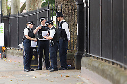 © Licensed to London News Pictures. 22/07/2016. LONDON, UK.  Police officers discussing their notes at the entrance of West Ham Lane Recreational Ground, known as Stratford Park on West Ham Lane in Stratford, where a man in his 20's was stabbed and killed yesterday afternoon. Two men were arrested nearby on suspicion of murder and taken into custody at an east London police station. Photo credit: Vickie Flores/LNP