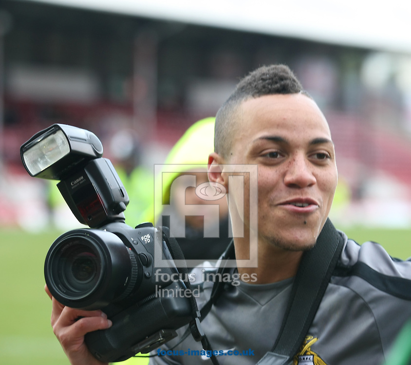 Picture by David Horn/Focus Images Ltd +44 7545 970036.27/04/2013.Kyle Bennett of Doncaster Rovers captures the moment his team win the nPower League 1 Championship after the npower League 1 match at Griffin Park, London.