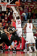 Nov 16, 2011; Fayetteville, AR, USA;  Arkansas Razorbacks forward Marshawn Powell (33) takes a shot over Oakland Grizzlies guard Laval Lucas-Perry (13) during a game at Bud Walton Arena. Arkansas defeated Oakland 91-68. Mandatory Credit: Beth Hall-US PRESSWIRE