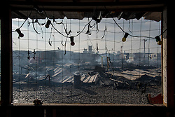 October 26, 2016 - Calais, France - Chaotic scenes of the jungle as the camp is evacuated, because of the danger from all the fires in Calais, France on 26 October 2016. Around one o clock, the jungle was evacuated, the entrances were blocked for safety reasons. More fires emerged all around the camp. The migrants were allowed to enter the camp around 5 o clock. (Credit Image: © Guillaume Pinon/NurPhoto via ZUMA Press)