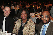 April 17, 2012 Washington, D.C: (L-R) Adam Adams, Honoree Debra Sandler, President, Mars Chocolate North America and Don Coleman, CEO & President, Global Hue attend Rev. Al Sharpton's  2012 National Action Network Convention held at the Walter E. Washington Convention Center from April 11-14, 2012 in Washington, D.C ...National Action Network (NAN) is one of the leading civil rights organizations in America and is at the forefront of the social justice movement, confronting issues such as police misconduct and abuse, voter rights, education, workers' right, healthcare awareness, anti-violence and more. Founded in New York City in 1991 by Rev. Al Sharpton and a group of activists, NAN is committed to the principles of nonviolent activism and civil disobedience as a direct outgrowth of the movement that was lead by the Rev. Dr. Martin Luther King, Jr. .(Photo by Terrence Jennings)