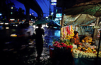 Selling flowers in the rain, Bangkok, Thailand, South East Asia.