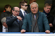 BBC political broadcaster Nick Robinson (l) talking to a friend in the stands before k/o. Barclays Premier league match, Chelsea v Manchester Utd at Stamford Bridge in London on Sunday 7th February 2016.<br /> pic by John Patrick Fletcher, Andrew Orchard sports photography.