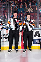 KELOWNA, BC - FEBRUARY 28: Referees Brett Iverson and Troy Paterson stand at the timekeepers box at the start of the game between Kelowna Rockets and the Everett Silvertips at Prospera Place on February 28, 2020 in Kelowna, Canada. (Photo by Marissa Baecker/Shoot the Breeze)