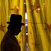 Cholita Alicia Flores waits behind the curtain before her introduction to the ring during the 'Titans of the Ring' wrestling group performance at El Alto's Multifunctional Centre. Bolivia. The wrestling group includes the fighting Cholitas, a group of Indigenous Female Lucha Libra wrestlers who fight the men as well as each other for just a few dollars appearance money. El Alto, Bolivia, 14th March 2010. Photo Tim Clayton