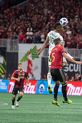 December 8, 2018 - Atlanta, Georgia, United States - dPortland Timbers forward JEREMY EBOBISSE (17) heads the ball over Atlanta United defender LEANDRO GONZALEZ (5) during the MLS Cup at Mercedes-Benz Stadium in Atlanta, Georgia.  Atlanta United defeats Portland Timbers 2-0 (Credit Image: © Mark Smith/ZUMA Wire)