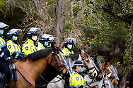 Large numbers of mounted police stand guard at the 120 Racecourse Road housing complex as tempers flair amid the third full day of the total lockdown of 9 housing commission high rise towers in North Melbourne and Flemington during COVID 19.After recording 191 COVID-19 cases overnight forcing Premier Daniel Andrews to announce today that all of metropolitan Melbourne along with one regional centre, Mitchell Shire will once more go back to stage three lockdowns from midnight Wednesday June 8. This comes as the residents of the housing commission towers in North Melbourne and Flemington finish their third day under extreme lockdown, despite only 27 cases being found in the towers. Members of the public gathered outside of the towers this afternoon in support of those trapped inside while riot police arrested two women for standing too close to the fence. While the women were later released, tensions are boiling over both in the towers and out. With 772 active cases in Victoria, NSW closed their border to Victoria effective at midnight tonight.