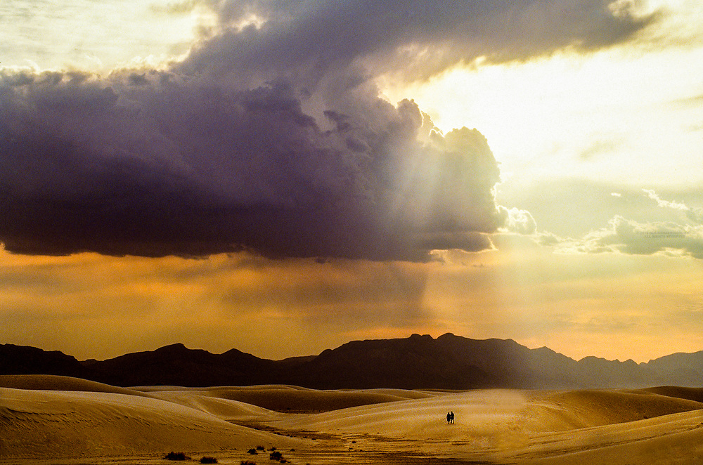 People hiking through the dunes at White Sands National Monument; New Mexico USA