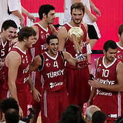 Turkey's players celebrate with the trophy after their their Adidas Istanbul Cup 2012 basketball final match Germany between Turkey at the Abdi ipekci Arena in Istanbul Turkey on Friday 03 August 2012. Turkey won 71-67. Photo by TURKPIX