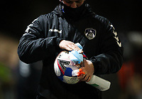 A member of the Oldham Athletic team cleans a ball<br /> <br /> Photographer Alex Dodd/CameraSport<br /> <br /> The EFL Sky Bet League Two - Oldham Athletic v Bolton Wanderers - Tuesday 2nd March 2021 - Boundary Park - Oldham<br /> <br /> World Copyright © 2021 CameraSport. All rights reserved. 43 Linden Ave. Countesthorpe. Leicester. England. LE8 5PG - Tel: +44 (0) 116 277 4147 - admin@camerasport.com - www.camerasport.com