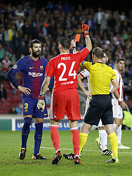 (L-R) Gerard Pique of FC Barcelona, goalkeeper Silvio Proto of Olympiacos, referee William Collum, Sasa Zdjelar of Olympiacos, Alberto Botia of Olympiacos during the UEFA Champions League group D match between FC Barcelona and Olympiacos on October 18, 2017  at the Camp Nou stadium in Barcelona, Spain.