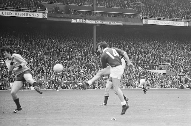 Galway kicks the ball towards the goal as Dublin player attempts to block it with his foot during the All Ireland Senior Gaelic Football Championship Final Dublin V Galway at Croke Park on the 22nd September 1974. Dublin 0-14 Galway 1-06.